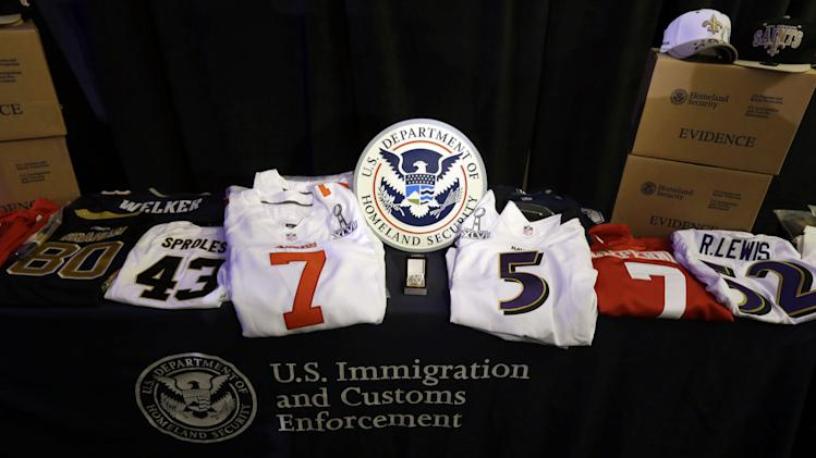 Confiscated counterfeit merchandise is displayed at a news conference regarding counterfeit NFL football merchandise and tickets for the upcoming Super Bowl XLVII in New Orleans, Thursday, Jan. 31, 2013. (AP Photo/Gerald Herbert)