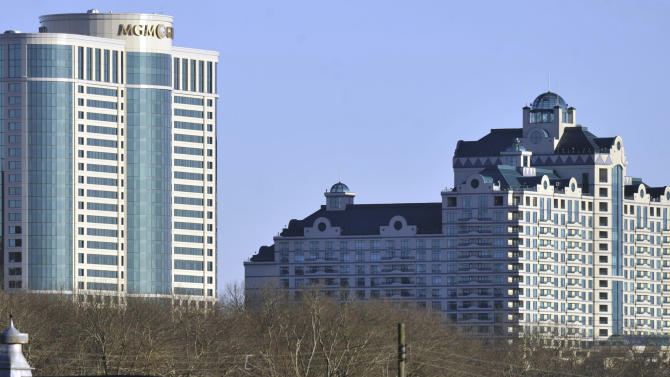FILE - In this Nov. 11, 2010 file photo, buildings of the Foxwoods Resorts Casino rise over the landscape in Ledyard, Conn.  Negotiations for a union contract at the country's largest casino in June 2013 are hitting a snag over footwear requirements for cocktail waitresses. (AP Photo/Jessica Hill, File)