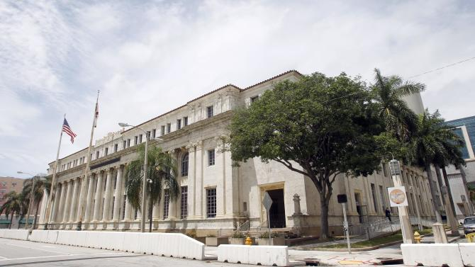 FILE - This Aug. 6, 2012 file photo shows the vacant David W. Dyer courthouse, in Miami. Millions of square feet of wasted space in federal courthouses that have opened since 2000 are costing U.S. taxpayers upwards of $51 million a year, congressional auditors reported Thursday. In addition to the extra space issue, Republican-controlled House committees have been investigating surplus and empty federal properties such as Miami's historic Dyer Courthouse, which opened in 1933, and has been vacant since 2008. (AP Photo/Alan Diaz, File)