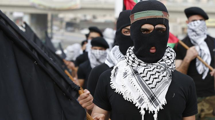 Palestinian refugees attend a demonstration calling for an end to the Israeli offensive in the Gaza Strip, at Al-Baqaa Palestinian refugee camp, near Amman