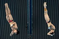China's Cao Yuan and Zhang Yanquan compete in the men's synchronised 10m platform final diving event at the London 2012 Olympic Games at the Olympic Park in London. The Chinese pair took gold