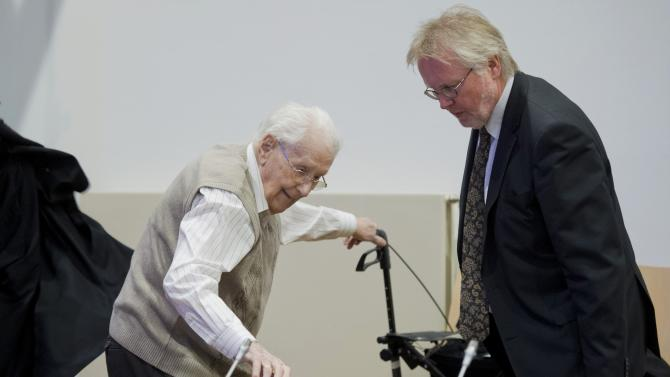 Former bookkeeper at Auschwitz Groening arrives with his lawyer Holtermann for start of his trial in Lueneburg
