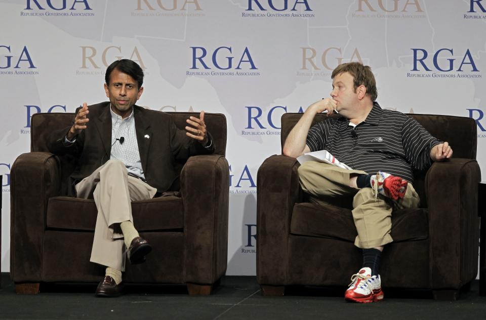Louisiana Gov. Bobby Jindal, left, speaks as political consultant Frank Luntz listens during a plenary session at  the Republican Governors Association annual conference in Orlando, Fla., Wednesday, Nov. 30, 2011. (AP Photo/John Raoux)