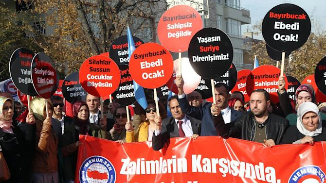 "Turkish demonstrators hold a banner and placards that read "" we are with resistance against aggressors"" as they protest Russian support to Assad regime in Syria, outside the Russian embassy in Ankara, Turkey, Tuesday, Nov. 24, 2015. Turkey shot down a Russian warplane Tuesday, claiming it had violated Turkish airspace and ignored repeated warnings. Russia denied that the plane crossed the Syrian border into Turkish skies. Russia said the Su-24 was downed by artillery fire, but Turkey claimed that its F-16s fired on the Russian plane after it ignored several warnings.(AP Photo)"