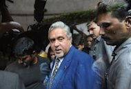 An arrest warrant for Indian tycoon Vijay Mallya, pictured in 2011, over alleged bounced cheques written by his troubled airline has been withdrawn after the carrier agreed to pay the sums due, reports said Wednesday
