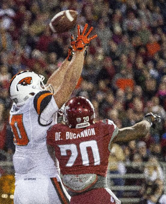 Mannion leads OSU over WSU 52-24