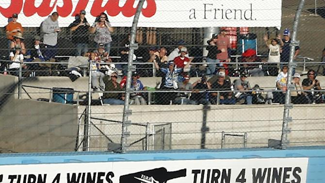 From left, Clint Bowyer (15), Jeff Gordon and Joey Logano crash in Turn 4 during the NASCAR Sprint Cup Series auto race at Phoenix International Raceway, Sunday, Nov. 11, 2012, in Avondale, Ariz. (AP Photo/The Arizona Republic, Rob Schumacher)  MARICOPA COUNTY OUT; MAGS OUT; NO SALES