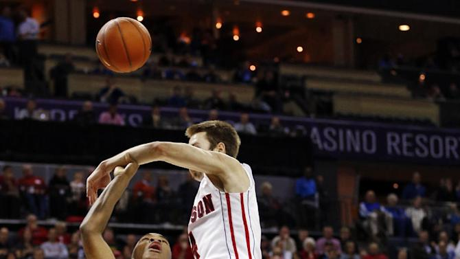 Duke's Rasheed Sulaimon (14) is fouled by Davidson's Tyler Kalinoski, right, during the first half of an NCAA college basketball game in Charlotte, N.C., Wednesday, Jan. 2, 2013. (AP Photo/Chuck Burton)