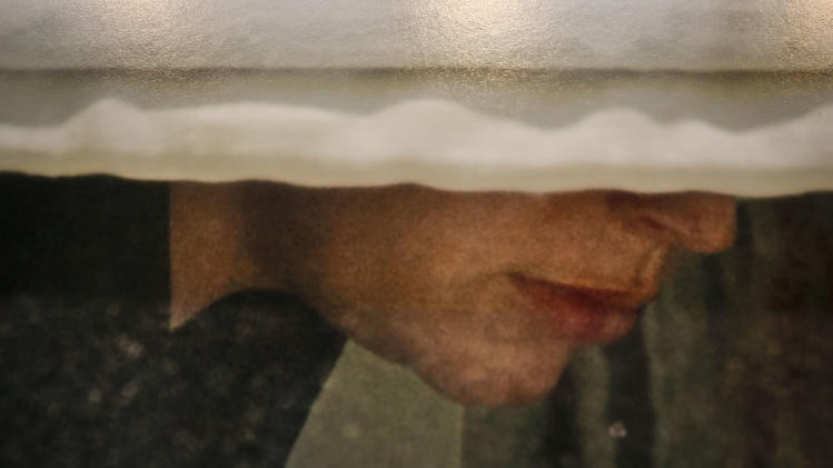 A detail section from the Photography of Arne Svenson as it hangs inside the Julie Saul Gallery on Thursday, May 16, 2013 in New York. Residents of a New York luxury apartment building are livid over an exhibition of photos secretly snapped through their apartment windows. (AP Photo/Bebeto Matthews)
