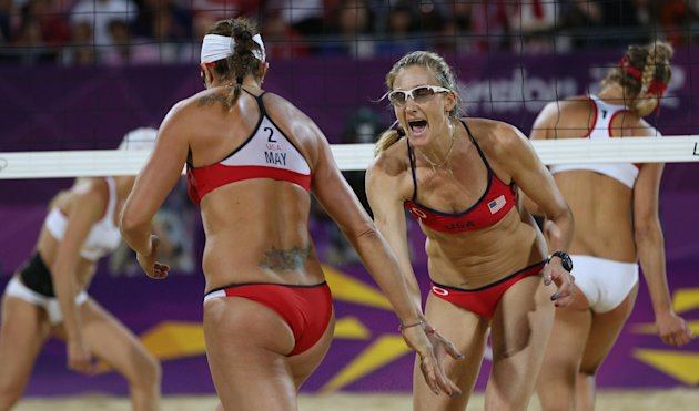 United States' Kerri Walsh Jennings, right, and Misty May-Treanor, left, react during the women's gold medal beach volleyball match against the other US team at the 2012 Summer Olympics, Wednesday, Au