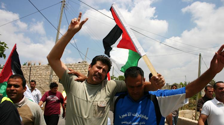 "This undated publicity photo released by Kino Lorber, Inc. shows Adeeb and Phil participating in a protest against the Israeli settlements in a scene from the documentary film, ""5 Broken Cameras,"" co-directed by Emad Burnat and Guy Davidi. (AP Photo/Kino Lorber, Inc.)"