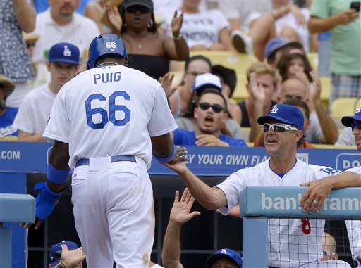 Puig's 1st 4-hit game leads Dodgers over Phils 6-1