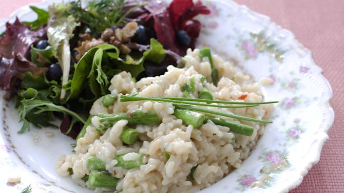 In this image taken on March 11, 2013, pressure cooker risotto with asparagus is shown served on a plate in Concord, N.H. (AP Photo/Matthew Mead)