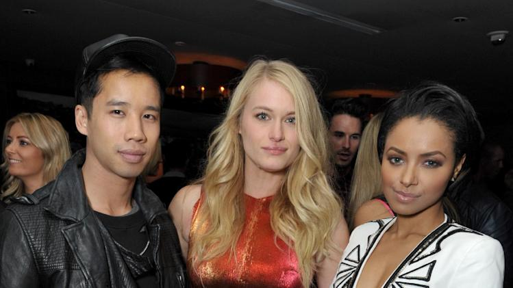 From right, Kat Graham, Leven Rambin and Jared Eng attend the DETAILS Hollywood Mavericks Party hosted by Dan Peres at Soho House on Thursday, Dec. 5, 2013, in West Hollywood, Calif. (Photo by John Shearer/Invision for DETAILS Magazine/AP Images)