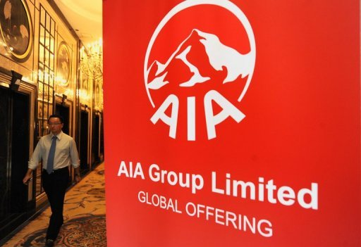 <p>People arrive for Asian insurer AIA's limited global offering in Hong Kong on October 6, 2010. US insurance giant American International Group (AIG) will sell its remaining stake in AIA, in a deal that could raise up to $6.5 billion.</p>