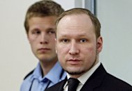 Mass-killer Anders Behring Breivik (right), pictured at his trial in Oslo. Young Norwegians injured in Breivik's shooting rampage on Utoeya island have testified for the first time, describing how he calmly hunted them down, but also taunting the killer of 77 people