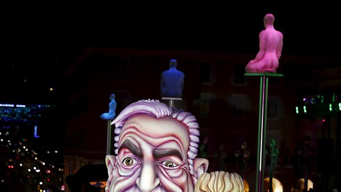 A giant figure of former IMF head Dominique Strauss-Kahn is paraded through the crowd during the Carnival parade in Nice