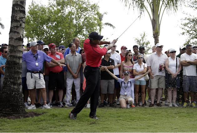 Tiger Woods hits form a fairway on the seventh hole during the final round of the Cadillac Championship golf tournament Sunday, March 9, 2014, in Doral, Fla. (AP Photo/Lynne Sladky)
