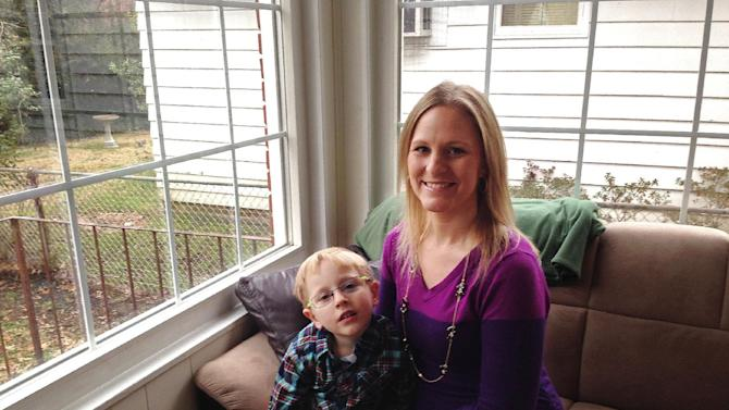 Sarah Bergstrom poses for a photo with her son Blake, 4, Friday, Jan. 17, 2014, in her home in Charleston, W.Va. The 29-year-old nurse who is 4 months pregnant with her second child was devastated when she learned after a ban on tap water was lifted days after a chemical leak that health officials urged pregnant women not to drink tap water until the chemical is entirely undetectable. (AP Photo/John Raby)