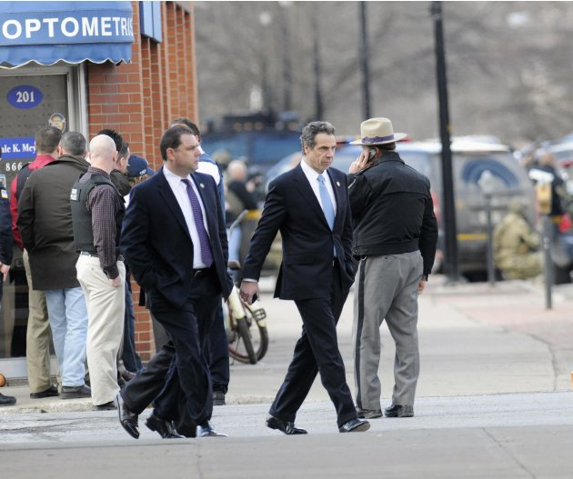 New York Governor Cuomo meets with local and state police, during a search for shootings suspect Kurt Meyers, along Main Street in Herkimer, New York