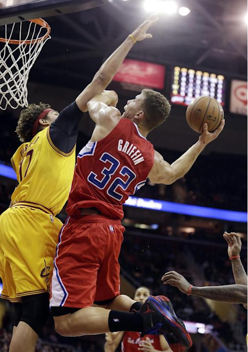 Los Angeles Clippers' Blake Griffin (32) jumps to the basket against Cleveland Cavaliers' Anderson Varejao (17), from Brazil, during the first quarter of an NBA basketball game on Saturday, De