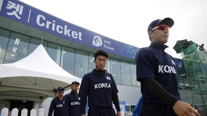 South Korea's cricket players make their way to their men's Twenty20 quarter-final cricket match against Sri Lanka at the 17th Asian Games in Incheon