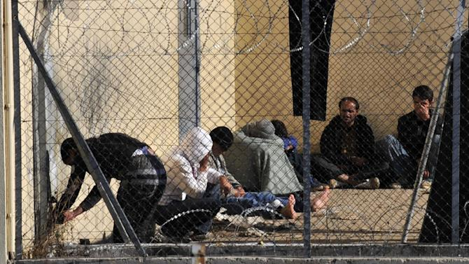 A group of illegal immigrants in detention center on Sunday, Oct. 31 2010 in Fylakio, northeastern Greece, 480 kilometers east of Thessaloniki.Despite a general decrease recently in illegal immigration towards the EU as jobs become scarcer due to the global financial crisis, the numbers are staggering. Greece now accounts for 90 percent of the bloc's detected illegal border crossings, compared to 75 percent in 2009. The EU's border agency, Frontex, says Greek authorities reported 45,000 illegal border crossings in just the first half of this year.(AP/Photo Nikolas Giakoumidis)