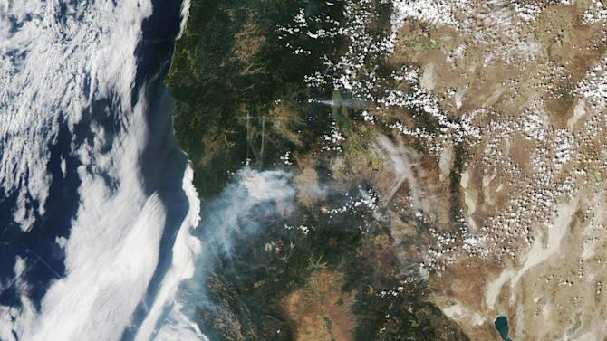 Wildfire activity in California is pictured in this NASA satellite image, on August 24, 2014