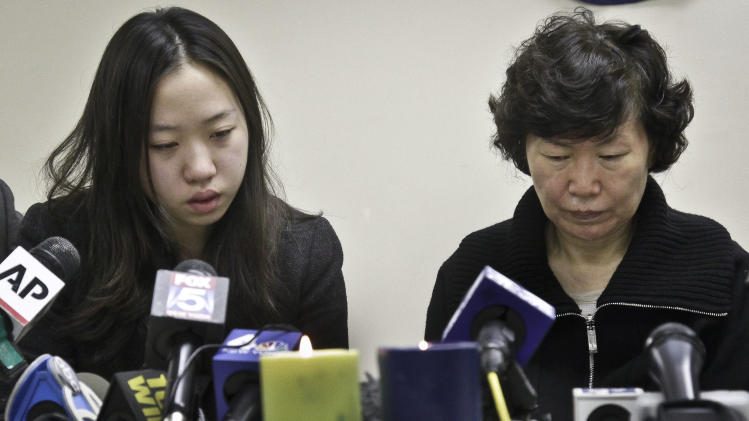 Ashley Han, 20,  sits next to her mother Serim Han, as she talks about her father Ki-Suck Han during a news conference on Wednesday, Dec. 5, 2012 in New York.  Naeem Davis, 30, was taken into custody for questioning Tuesday after security video showed a man fitting the suspect's description working with street vendors near Rockefeller Center. Police said Davis made statements implicating himself in Ki-Suck Han's death.  Witnesses told investigators they saw a man talking to himself Monday afternoon before he approached the 58-year-old Han of Queens at the Times Square station, got into an altercation with him and pushed him into the train's path.(AP Photo/Bebeto Matthews)