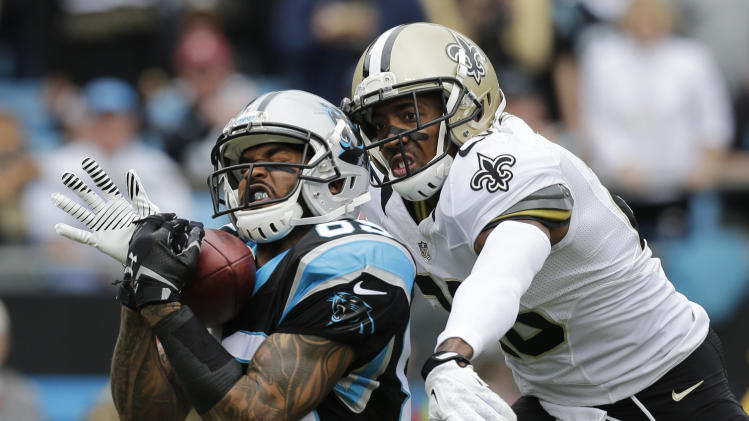 "FILE - In this Dec. 22, 2013 file photo, Carolina Panthers' Steve Smith, left, catches a pass as New Orleans Saints' Keenan Lewis, right, defends in the first half of an NFL football game in Charlotte, N.C.The agent for Smith says the five-time Pro Bowl selection has played his final snap for the Panthers. Smith's longtime representative Derrick Fox told The Associated Press on Wednesday, March 12, 2014, that Smith ""is not going to play for the Panthers next year, I know that. I just don't know when that transaction is going to take place."" (AP Photo/Chuck Burton, File)"