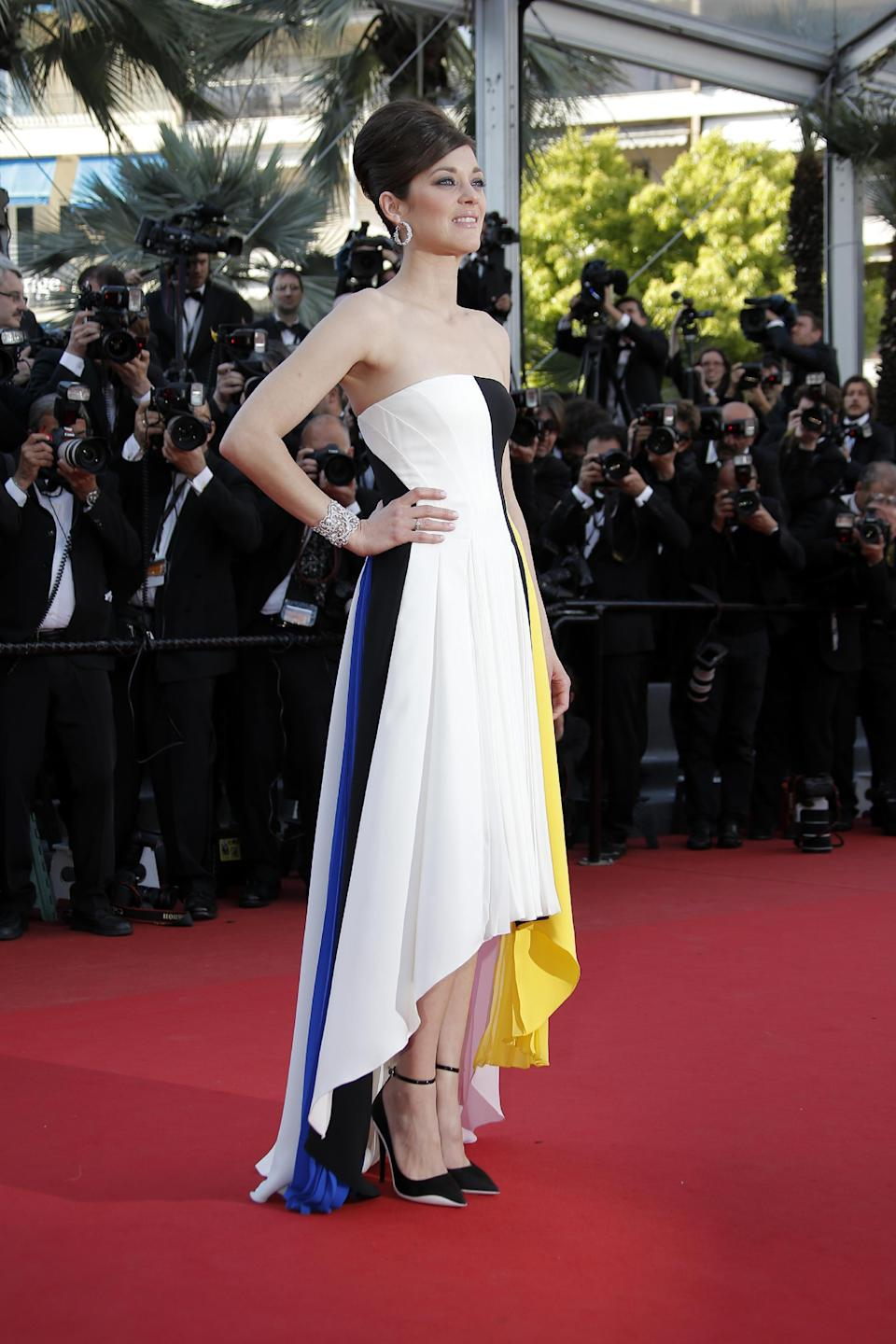 FILE - This May 20, 2013 file photo shows actress Marion Cotillard wearing a multi-colored bustier Dior dress with asymmetric hemline the screening of Blood Ties at the 66th international film festival, in Cannes, southern France. (AP Photo/Lionel Cironneau, file)