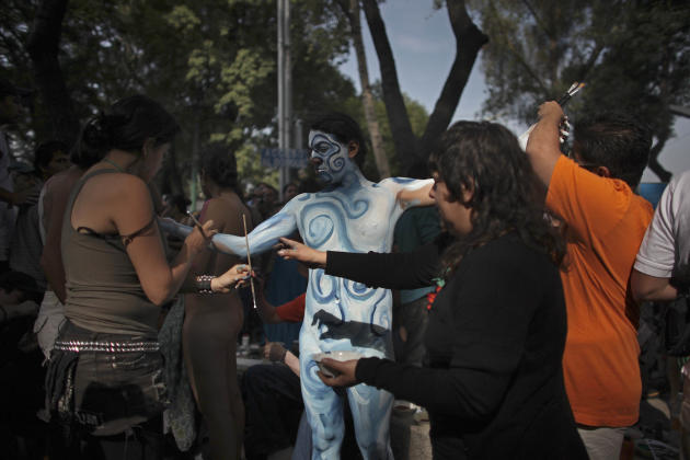 "A nude cyclist has his body painted before taking part in the ""The World Naked Bike Ride,"" a protest demanding respect from motorists and protesting the car-oriented culture in Mexico City, Saturday J"