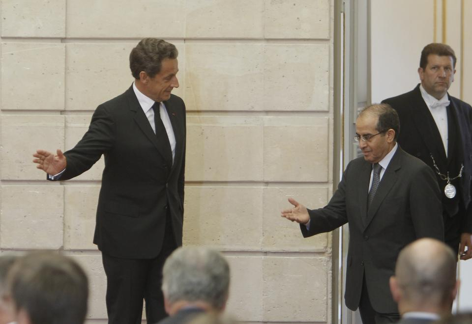 France's President Nicolas Sarkozy, rigth, arrives  with  the head of Libya's opposition government Mahmoud Jibril  at their meeting at the Elysee Palace in Paris. Wednesday, Aug. 24, 2011. (AP Photo/Jacques Brinon)