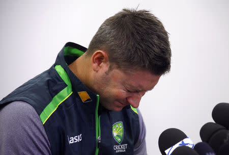 Australian cricket captain Michael Clarke cries as he reads a tribute to Phillip Hughes, who died on Thursday, during a media conference at the Sydney Cricket Ground