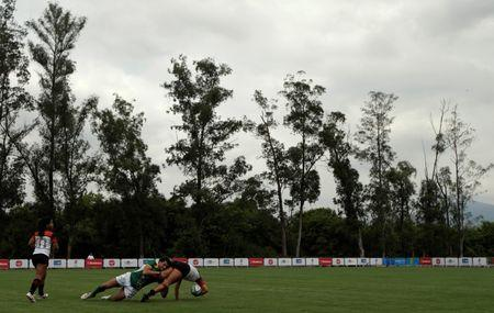Rugby players perform during the inauguration of the Deodoro Stadium which will host rugby sevens' Olympic debut and riding and combined sections of the modern pentathlon during the Rio 2016 Olympic Games in Rio de Janeiro