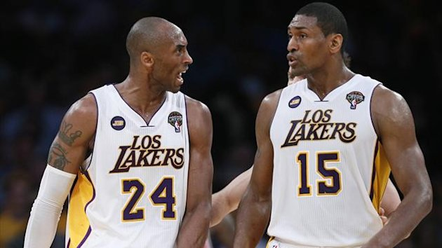 Los Angeles Lakers Kobe Bryant (L) berates Metta World Peace for committing a foul during their NBA game against the Chicago Bulls in Los Angele