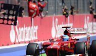 Ferrari&#39;s Spanish driver Fernando Alonso celebrates winning at the Valencia Street Circuit in Valencia during the European Formula One Grand Prix