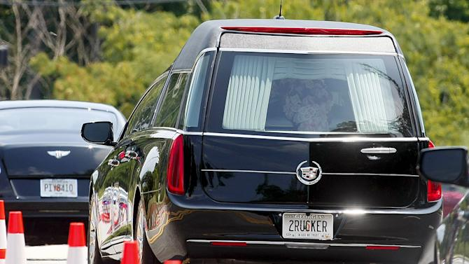 Hearse carrying the body of Bobbi Kristina Brown, the only child of singer Whitney Houston, leaves after her funeral at Saint James United Methodist Church in Alpharetta