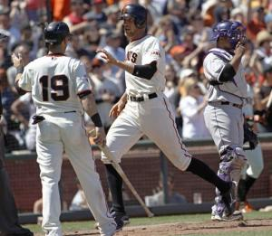 Belt, Cain help Giants beat Rockies 7-3