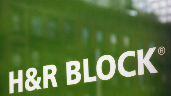 FILE - This March 5, 2012, file photo, shows a sign for H&R Block at an office, in New York. The tax service provider reports earnings, Tuesday, Dec. 10, 2013. (AP Photo/Mark Lennihan, File)