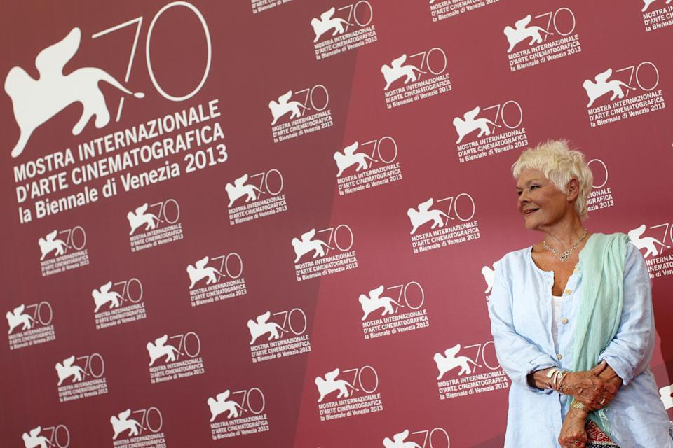 Actress Judi Dench poses for photographers during a photo call to promote the film Philomena at the 70th edition of the Venice Film Festival held from Aug. 28 through Sept. 7, in Venice, Italy, Saturday, Aug. 31, 2013. (AP Photo/Andrew Medichini)