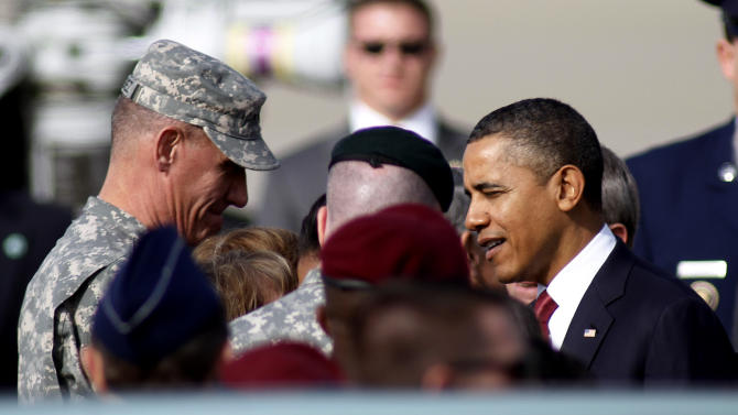 President Barack Obama speaks with Gen. David Rodriguez, left, upon his arrival at Pope Army Field in Fort Bragg, N.C., Wednesday, Dec. 14, 2011. (AP Photo/Jim R. Bounds)