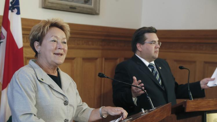 Marois speaks to the media with Coderre in Montreal