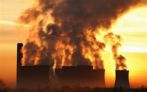 The sun rises behind Fiddlers Ferry coal fired power station near Liverpool