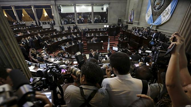 Members of the media await a vote by the congress to decide if Molina is to be stripped of his presidential immunity, in Guatemala City