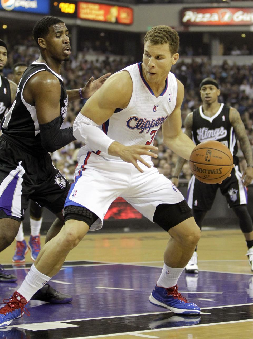 Los Angeles Clippers forward Blake Griffin, right, drives against Sacramento Kings forward Jason Thompson during the first quarter of an NBA basketball game in Sacramento, Calif., Wednesday, April 17, 2013. (AP Photo/Rich Pedroncelli)