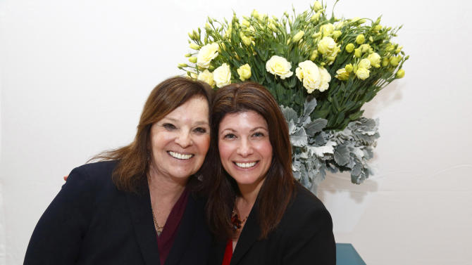 "In this March 31, 2012 photo, mother and daughter founders Francine Baras, left, and Nicole Baras Feuer attend their Start Over Smart Divorce Expo in New York. A smattering of vendors set up booths offering everything from a divorce planning binder to advice on long-term insurance, with seminars on such topics as ""Sensuality Secrets"" and ""My Formerly Hot Life.""  (AP Photo/Charles Sykes)"