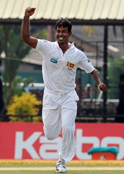 Sri Lanka's Nuwan Kulasekara celebrates after dismissing New Zealand's Martin Guptill during the first day of the second and final Test cricket match between Sri Lanka and New Zealand at the P