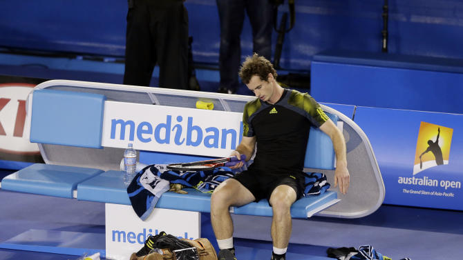 Britain's Andy Murray rests after his loss to Serbia's Novak Djokovic in the men's final at the Australian Open tennis championship in Melbourne, Australia, Sunday, Jan. 27, 2013. (AP Photo/Andy Wong)
