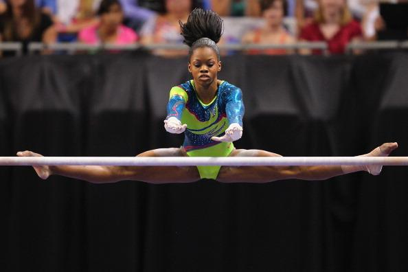 Gabrielle Douglas competes on the uneven bars during the Senior Women's competition on day four of the Visa Championships at Chaifetz Arena on June 10, 2012 in St. Louis, Missouri. (Photo by Dilip Vishwanat/Getty Images)